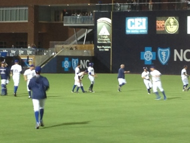 Durham Bulls players celebrate a 14-inning victory at DBAP!